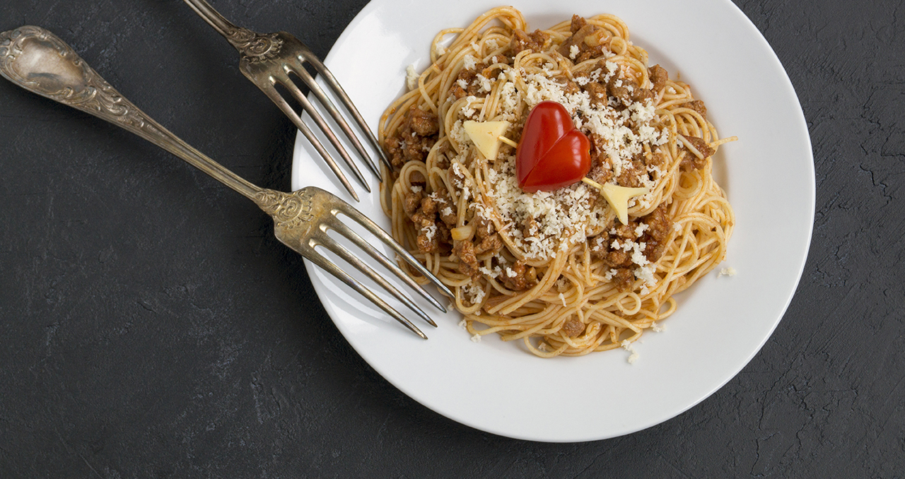 Valentines Day pasta dish with cheese and two forks.